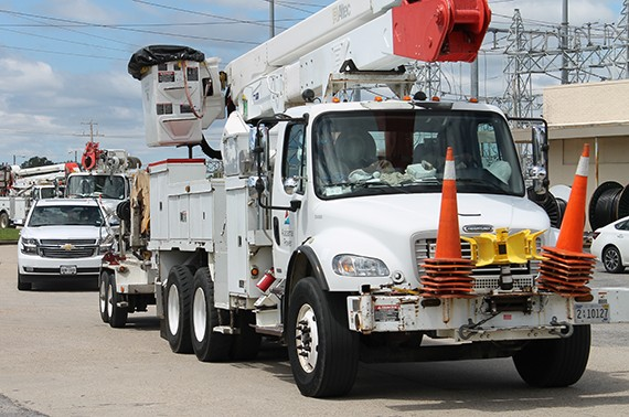 Fleet of Alabama Power Utility Trucks on a street